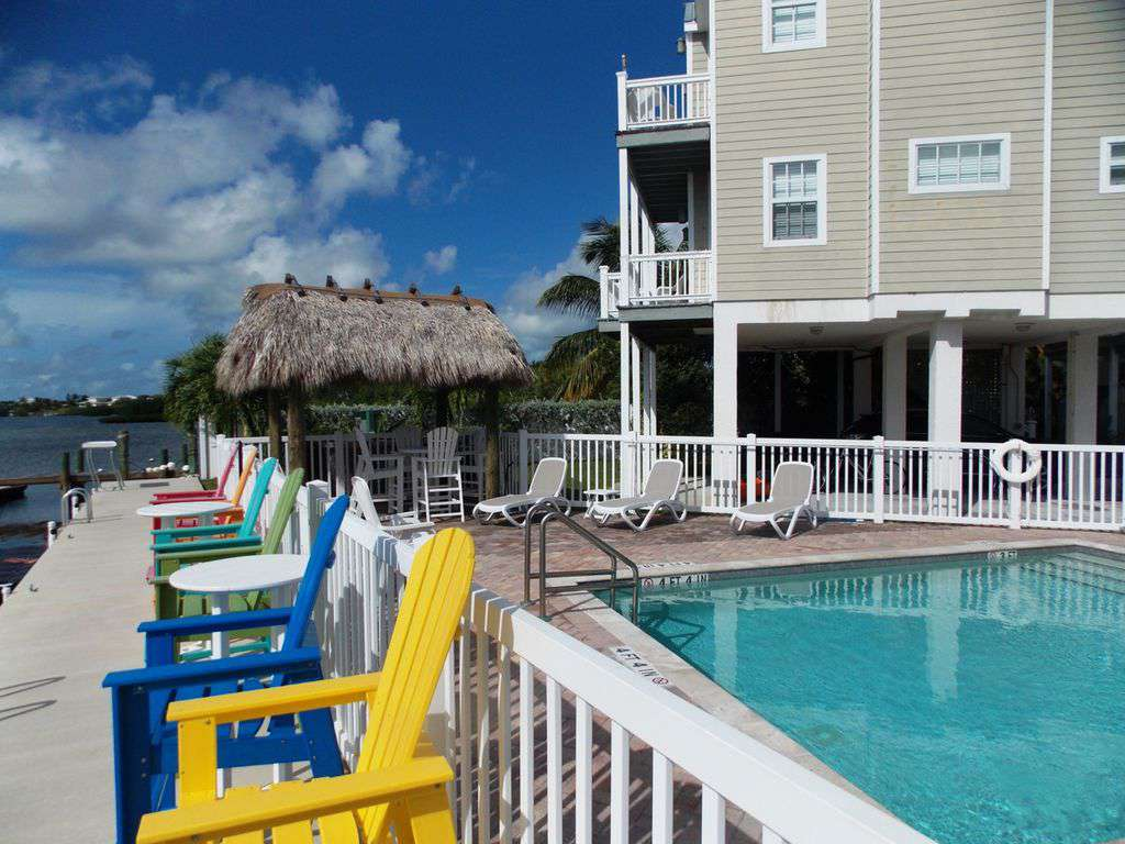 Tiki-Hut lounge area at Pool EASY BOOKING personal service CALL  305-735-3636