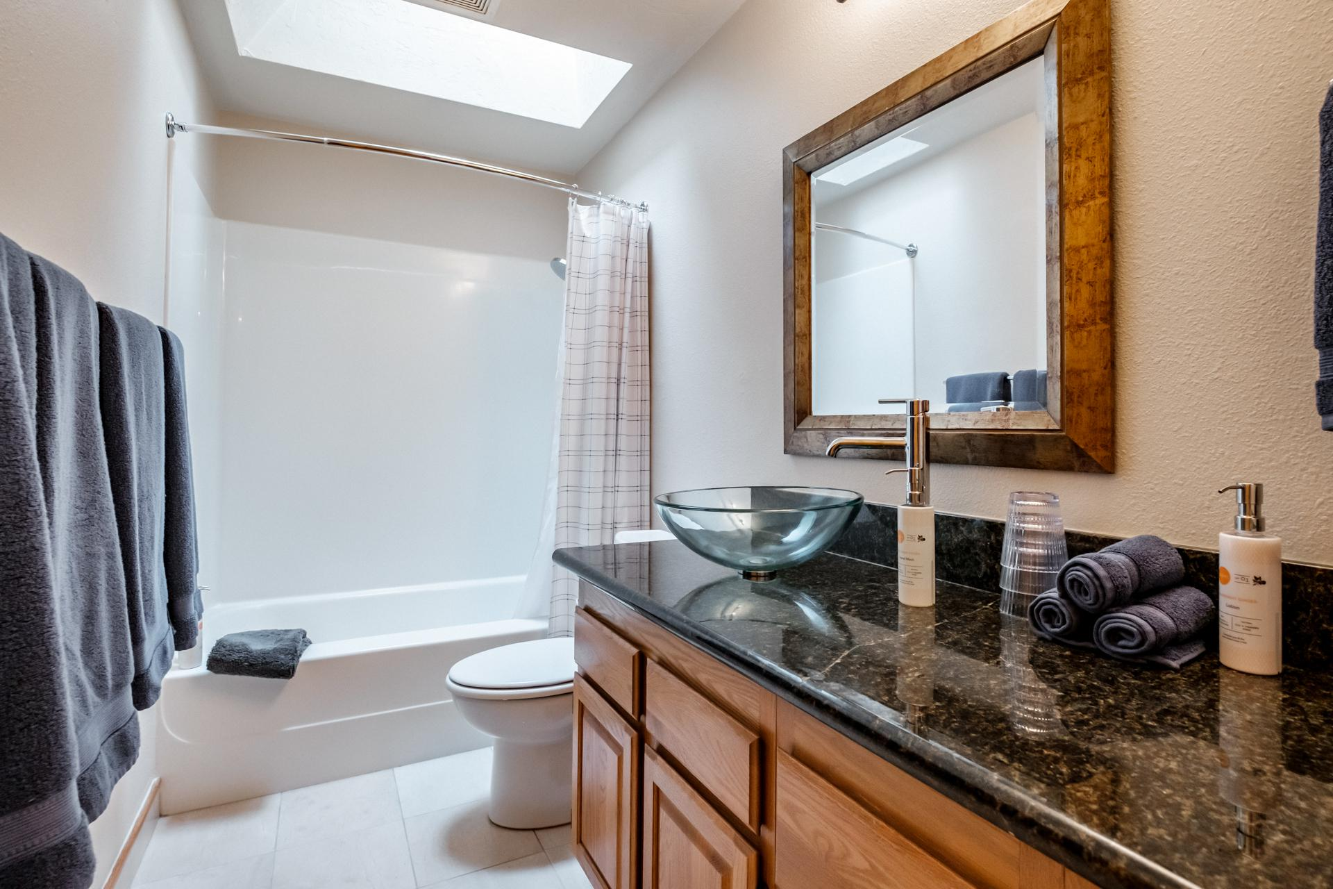 Spacious hall bathroom shared by bedroom 1 and bedroom 2