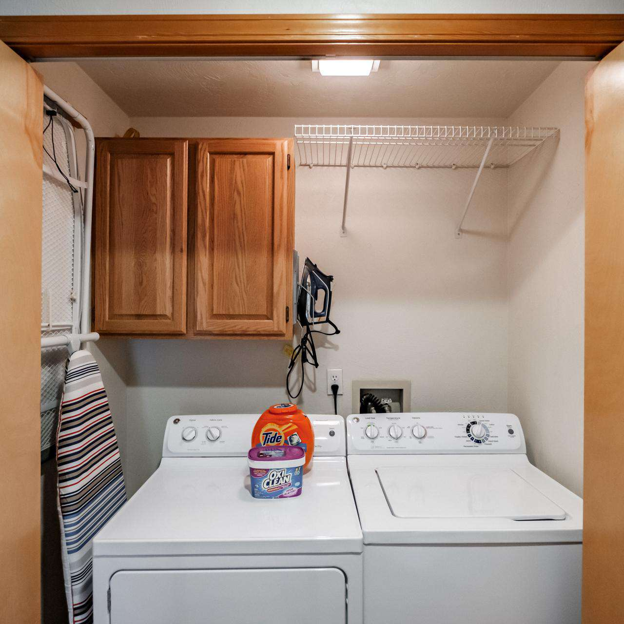 Utility Closet - Ironing board and iron.