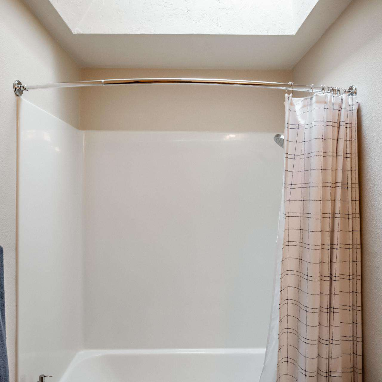 Tub Shower with skylight in the hall bathroom