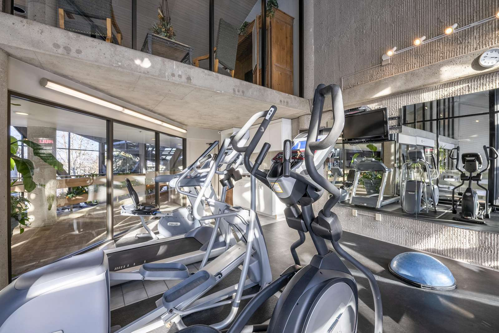 Exercise equipment is on the same level as the condo