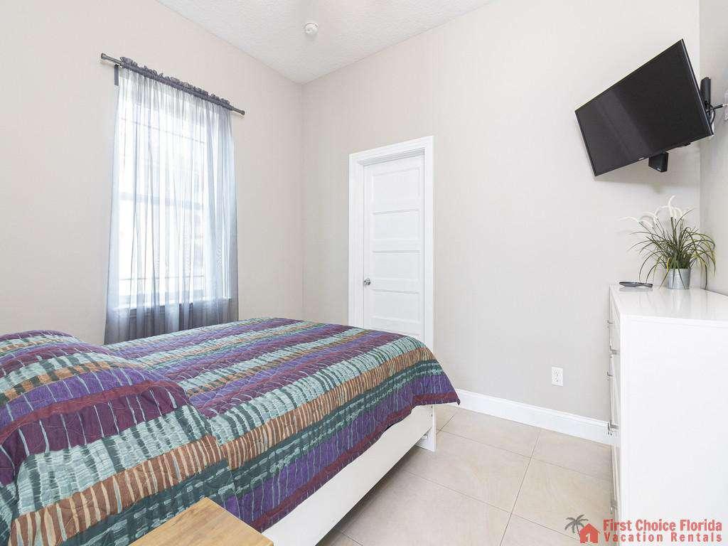 Sea View First Floor Queen Bedroom & Television