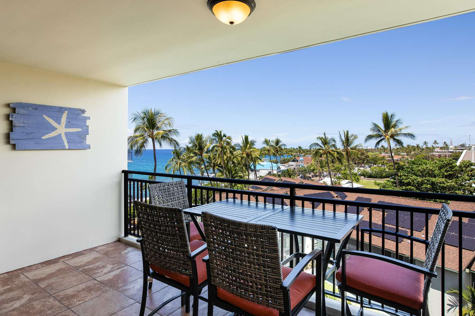 Spacious lanai with ocean and village views.