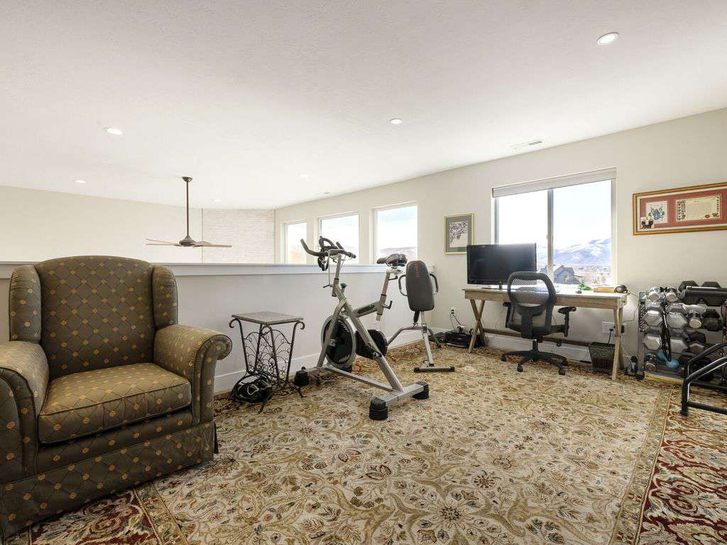 Loft area with desk and exercise equipment