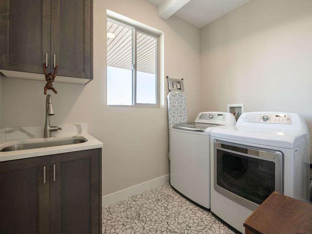 Laundry room off of kitchen on main floor