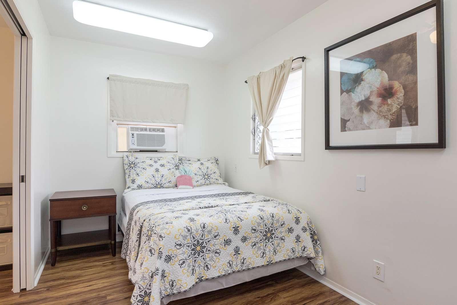 Bedroom B with lockable pocket door connecting to Master bedroom