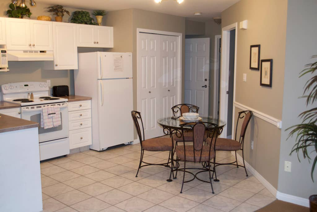 Kitchen and entrances to bedrooms. The first door on right is the bedroom with the single Queen. The second door is the door to the bathroom that also has an entrance from the bedroom. Entrance to second bedroom is to the left of the bathroom door.