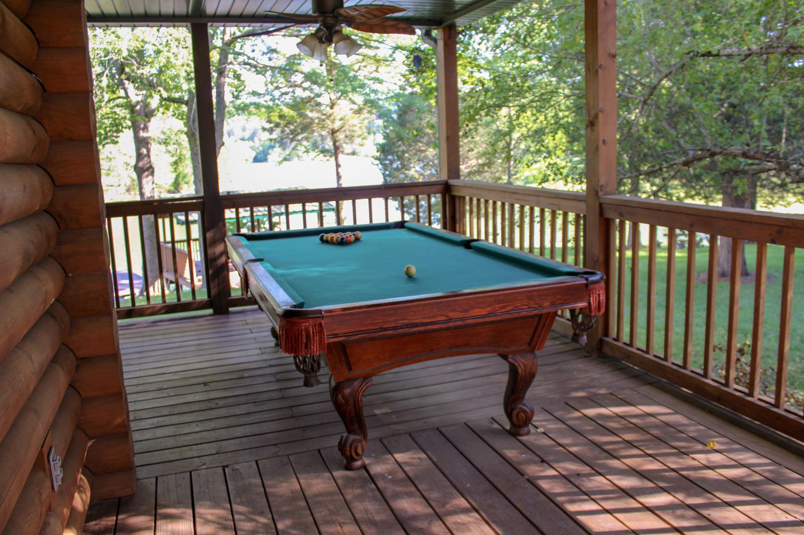 POOL TABLE OVER LOOKING THE LAKE