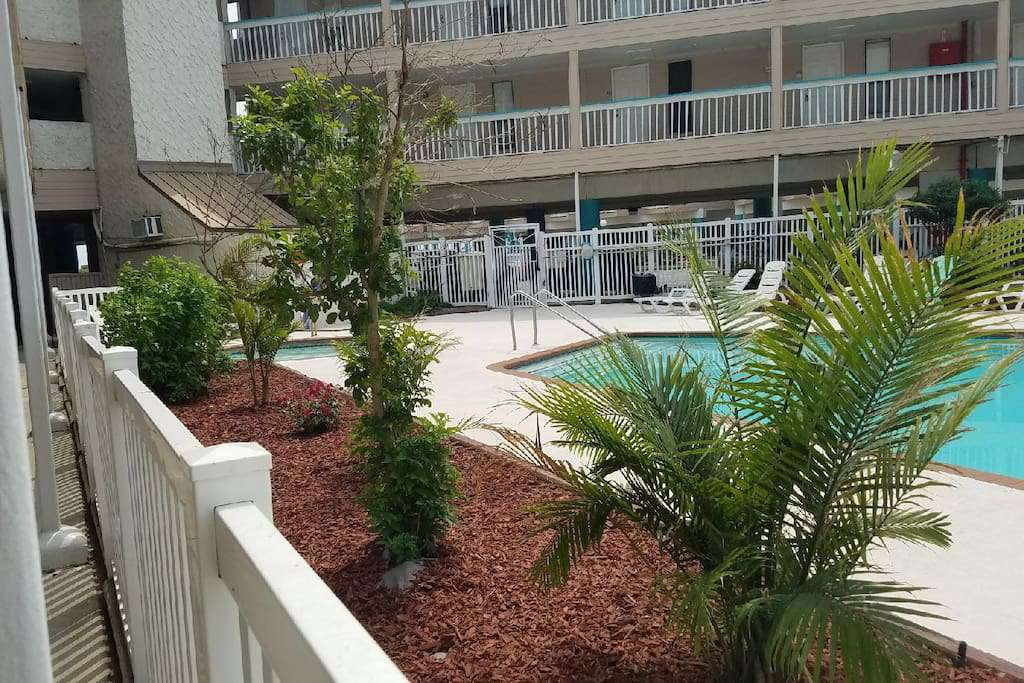 looking directly out over the pool, easy access to the pool and this Condo especially makes it real easy with the kids