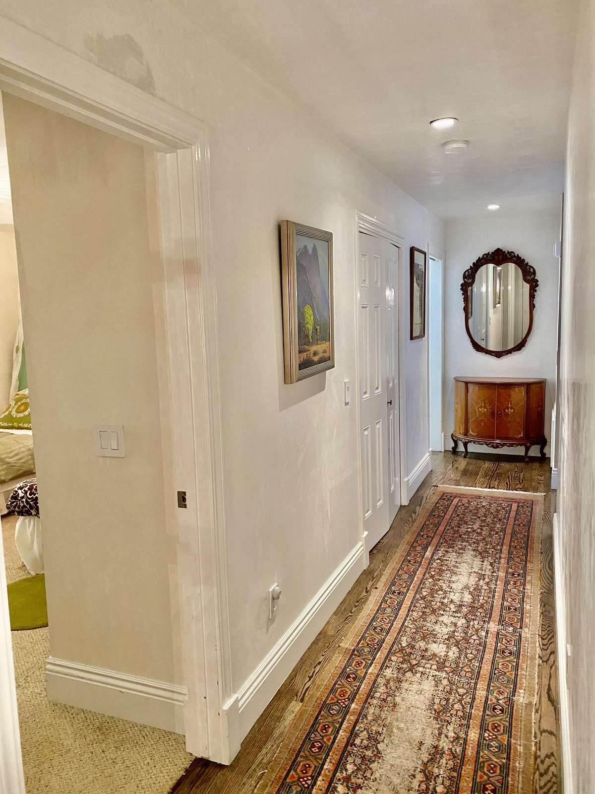 Main hallway looking toward kitchen from bedrooms 3 & 4