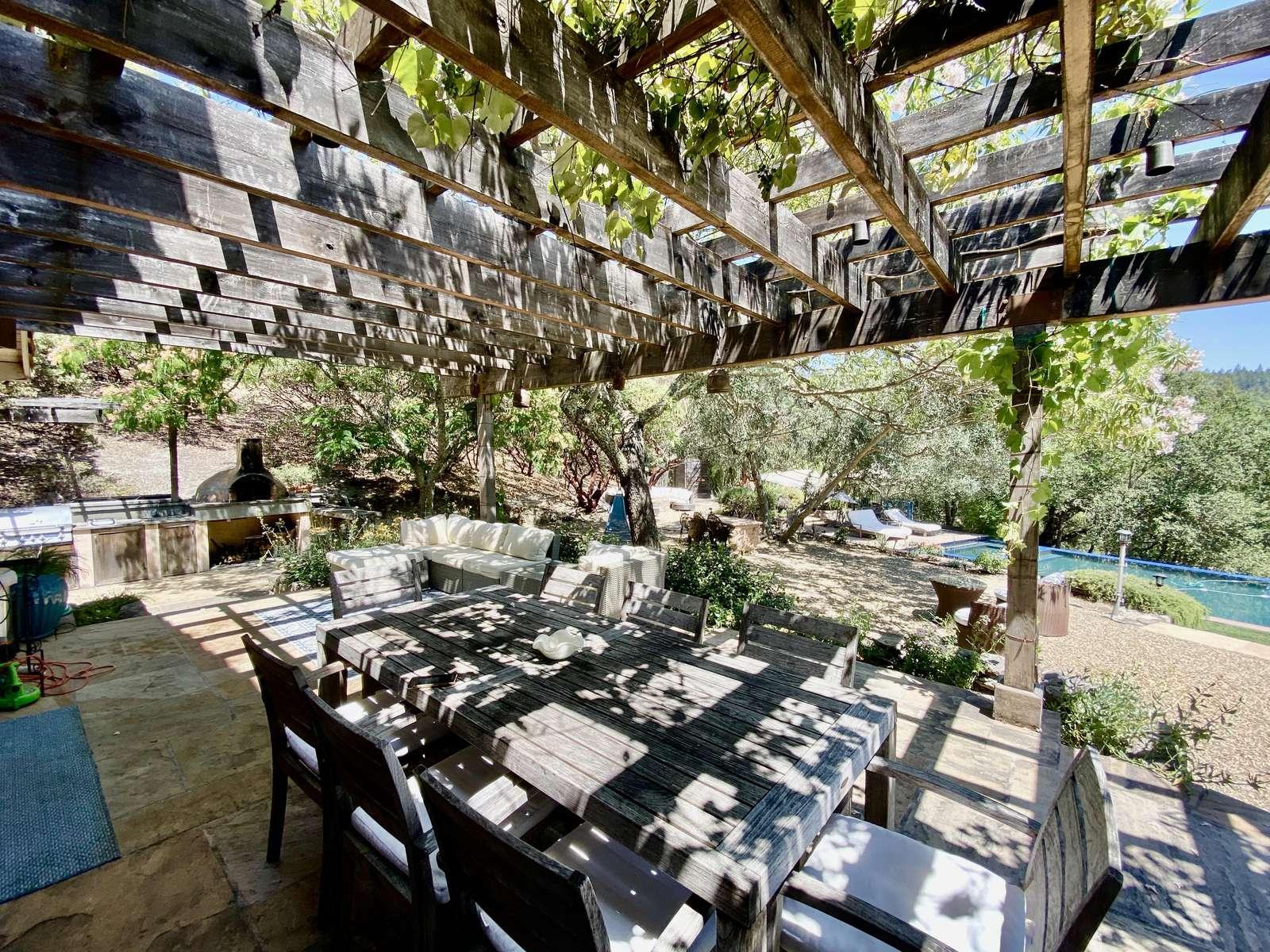 Outdoor dining under the trellised loggia