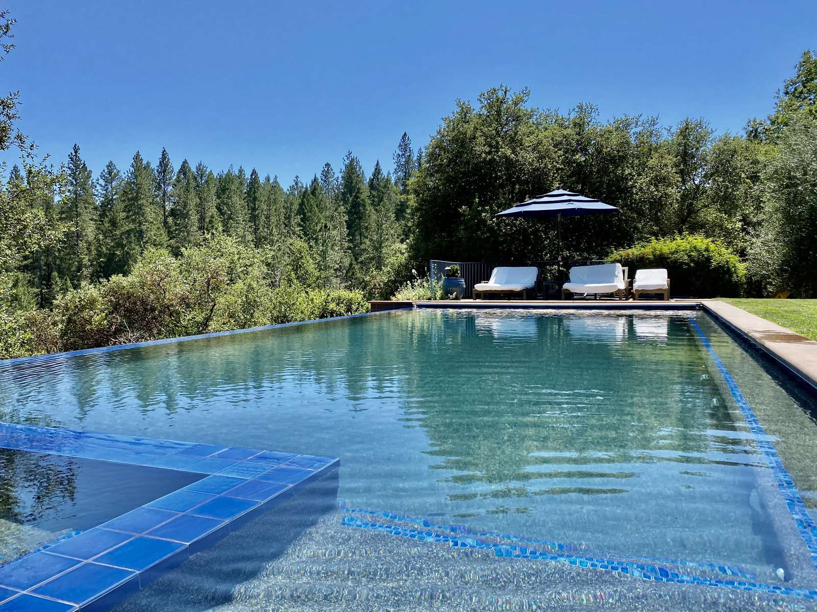 Plenty of shaded and sunny longing on both sides of the large heated pool