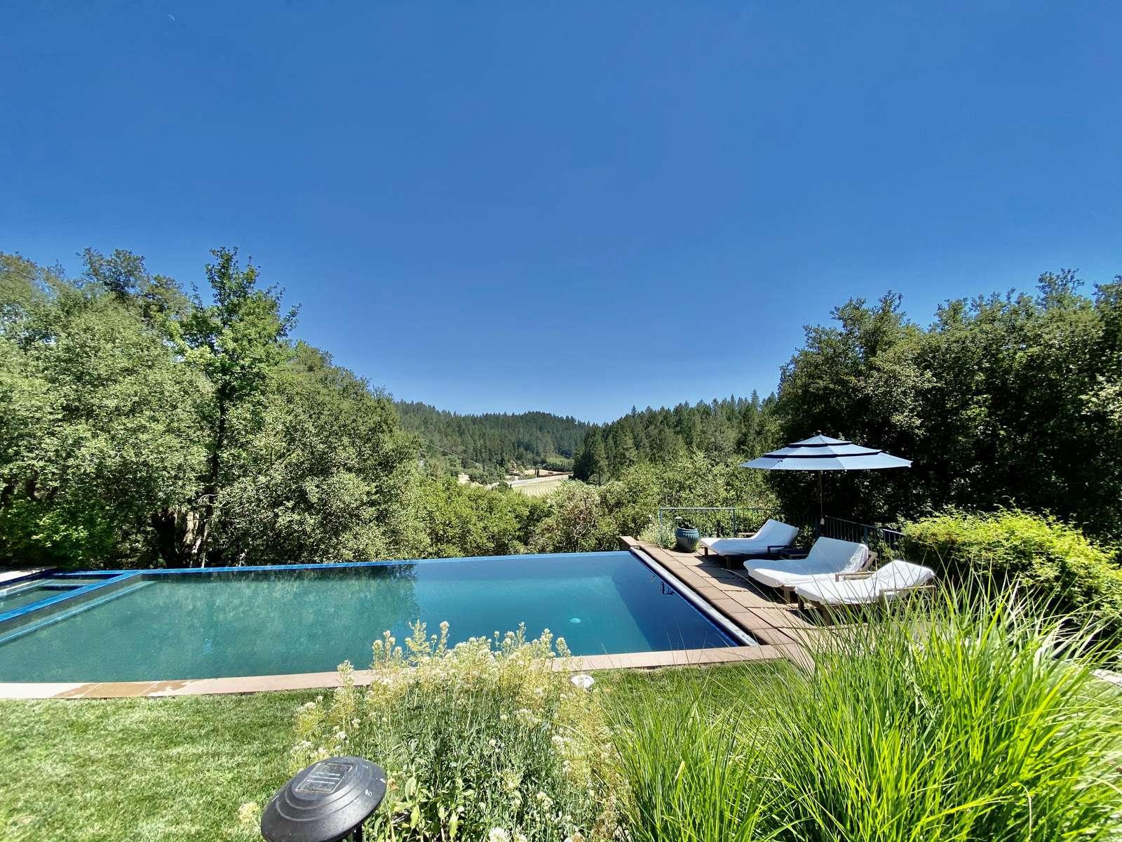 Villa Luba Helena's large heated infinity edge pool overlooking Napa Valley