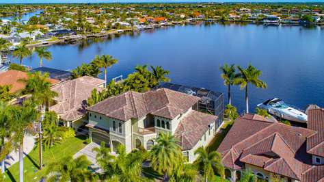Tropical Waterfront Paradise with Gulf Access. Heated infinity pool and spa.