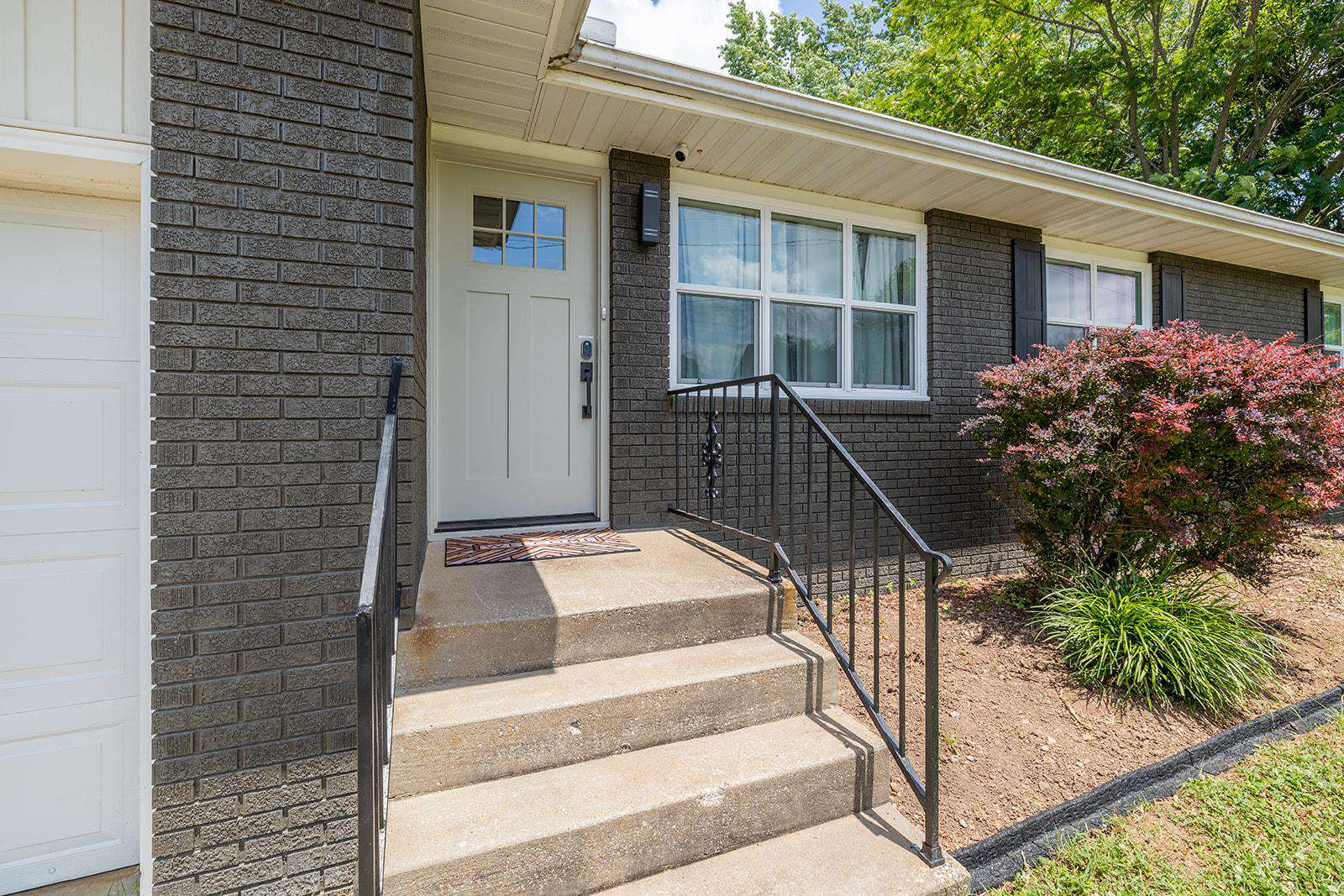Handrails, make these steps easy. Keyless entry on the door. Let yourself in!