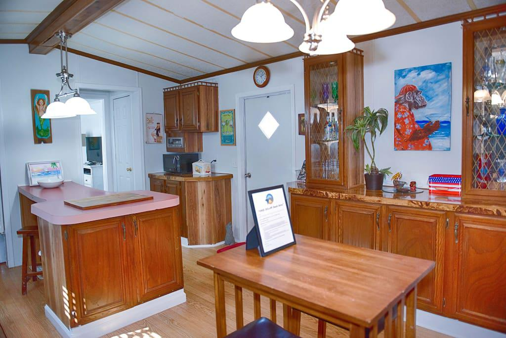Full Kitchen w/ combo stove/range and microwave. Start ammenities for kitchen are provided.