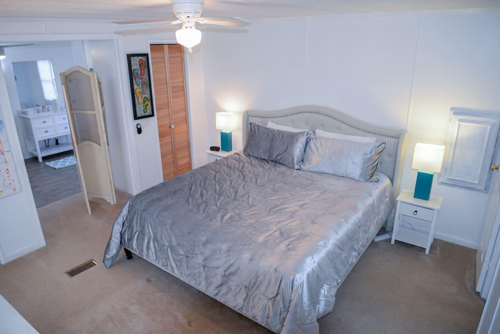 Master Bedroom with King Size Bed, ceiling Fan, Flat Screen TV, DVD player, and WOW Cable