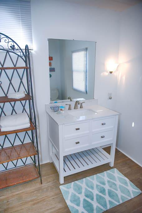 Master Bath with Shower Tub Combo, Full size Mirror, Vanity w/ mirror, Towels, Hand Towels, and Wash Cloths along with Starter set of amenities for our Guests use.