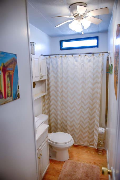 2nd Bathroom with Shower/tub combo...toilet...vanity...towels, hand towels, washcloths, and starter set of amenities.