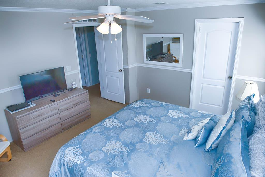 Master Bedroom with King Size Bed, ceiling fan, flat screen tv, dvd player, & WOW Cable