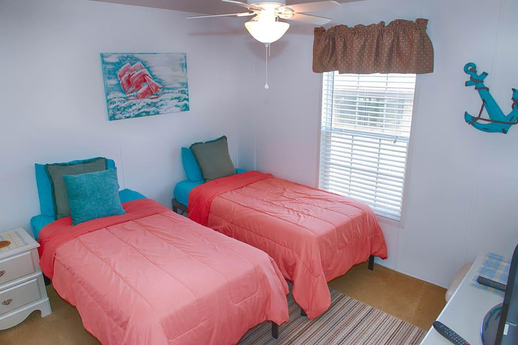Bedroom 2 with 2 twin beds and flat screen Tv w/ WOW Cable