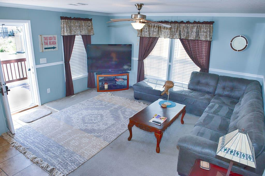 Den with Large Flat Panel TV w/ WOW Cable and DVD Player