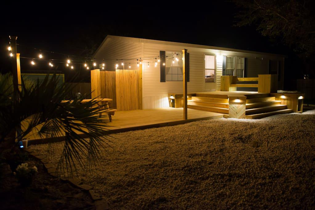 Huge Outdoor Deck with String Lights and accent lights, picnic table, outdoor shower, charcoal grill (charcoal not provided) & palm trees