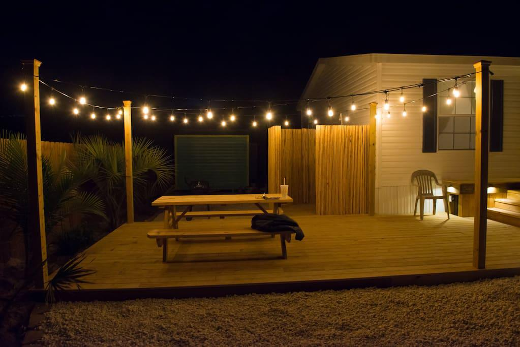 Night view of deck with Accent Lighting and String Lighting