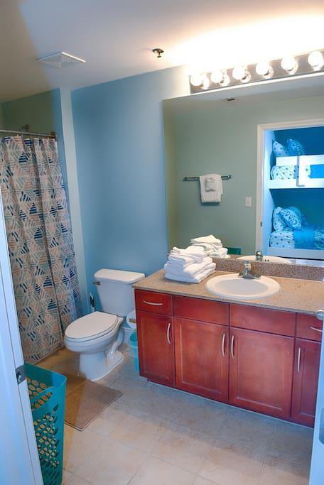 Bath #2 with Towels, Hand Towels, & Wash Cloths provided. Starter set of Toilet Paper, Soap, Shampoo & Conditioner provided. Shower Tub combo will get you clean after a sandy day at the beach