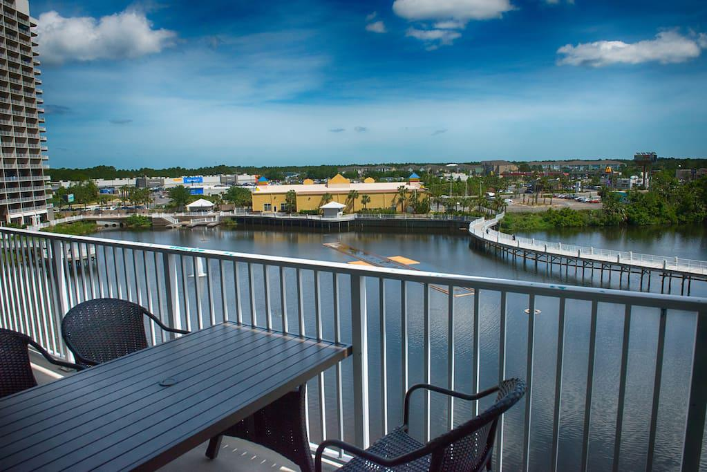 Balcony View of Lake with patio Furniture and chairs for 6 people