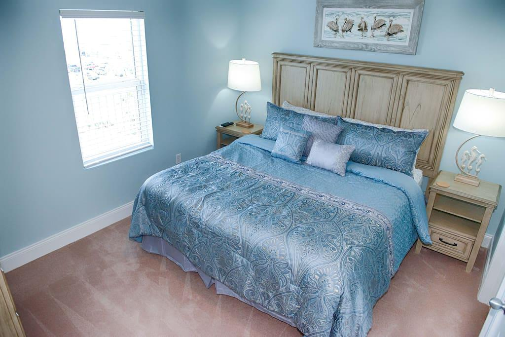 Master Bedroom with super comfy King Size bed...view the Gulf of Mexico out your bedroom window!