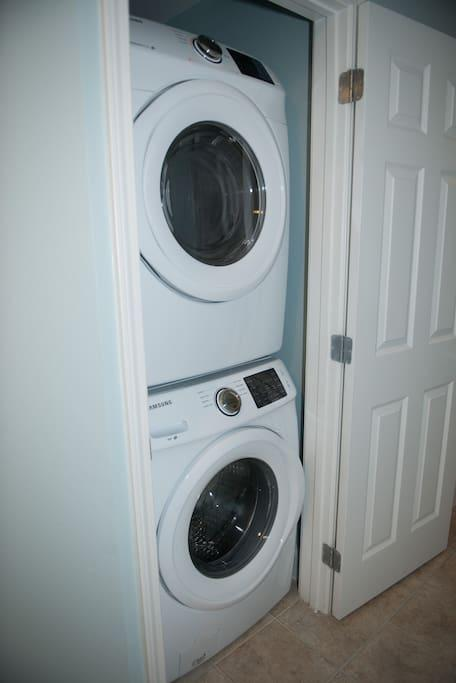 Brand New Full Size Digital Samsung Stackable Washer & Dryer with a complimentary load of Washing powder