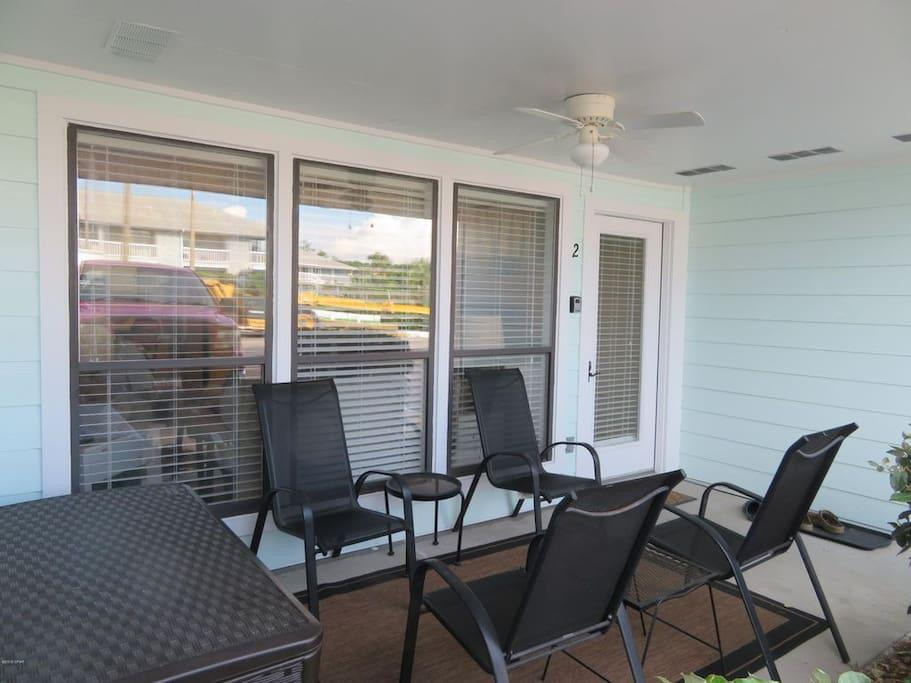 Front Porch with four chairs on the ground floor