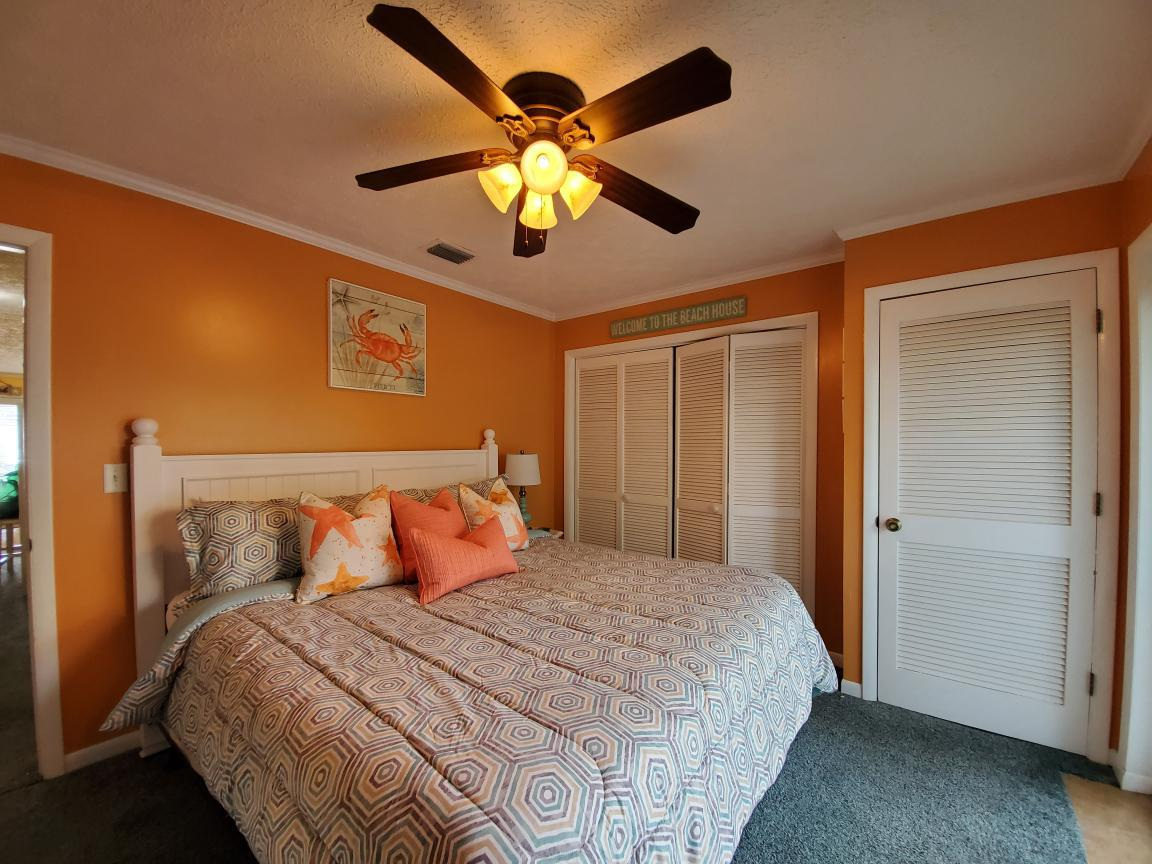 Master Bedroom with King size Bed and Sliding Glass door out to back porch