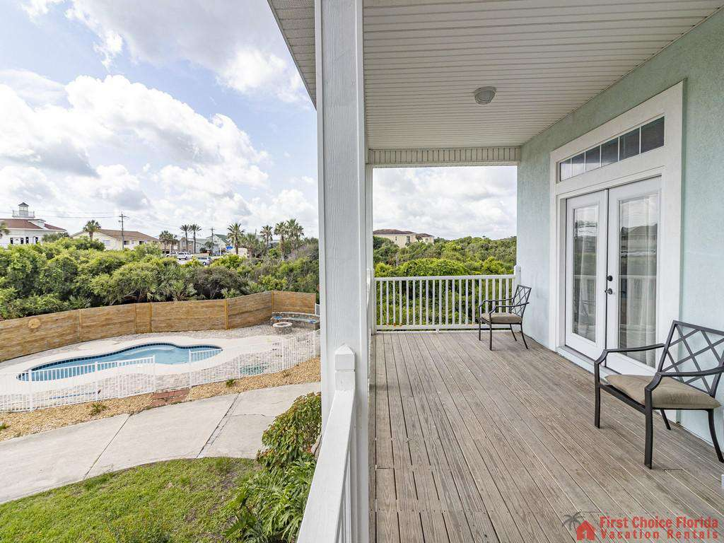 Coastal Hideaway Porch View of Pool