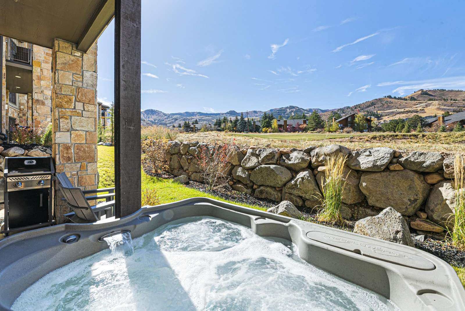 Private hot tub and barbeque grill with mountain views