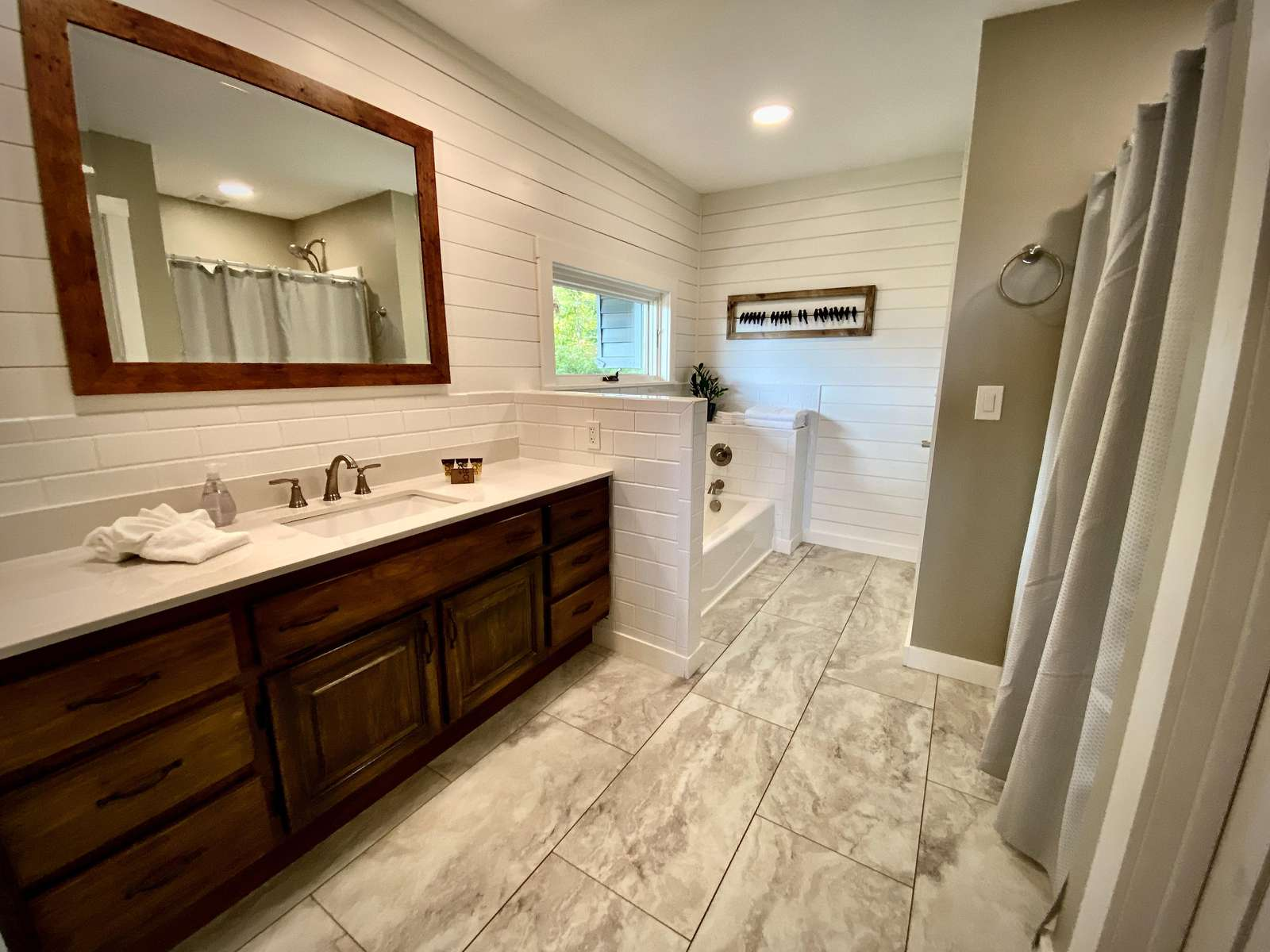 Master Bathroom offers a Shower and Separate Soaker Tub