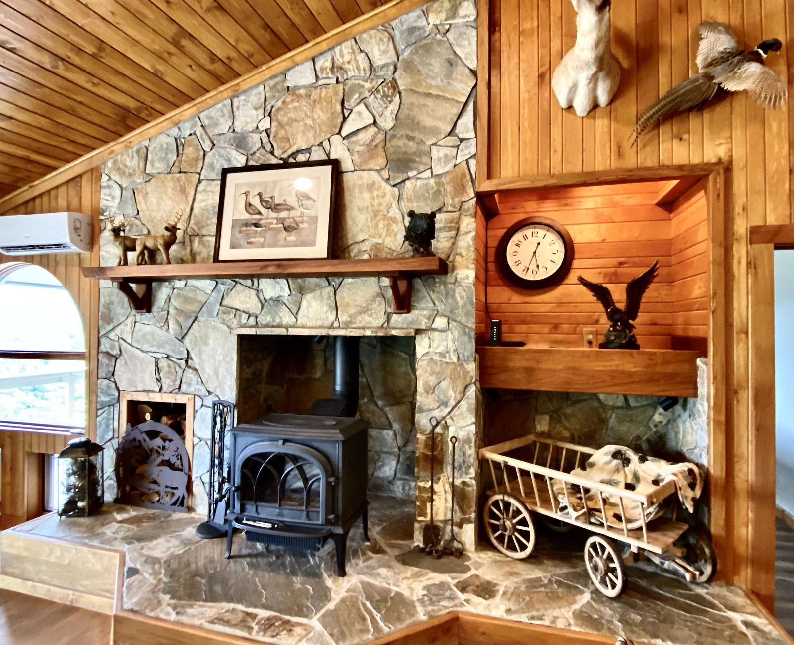 Wood Burning Fireplace and Native Stone surrounding it is a Living-room Focal Point