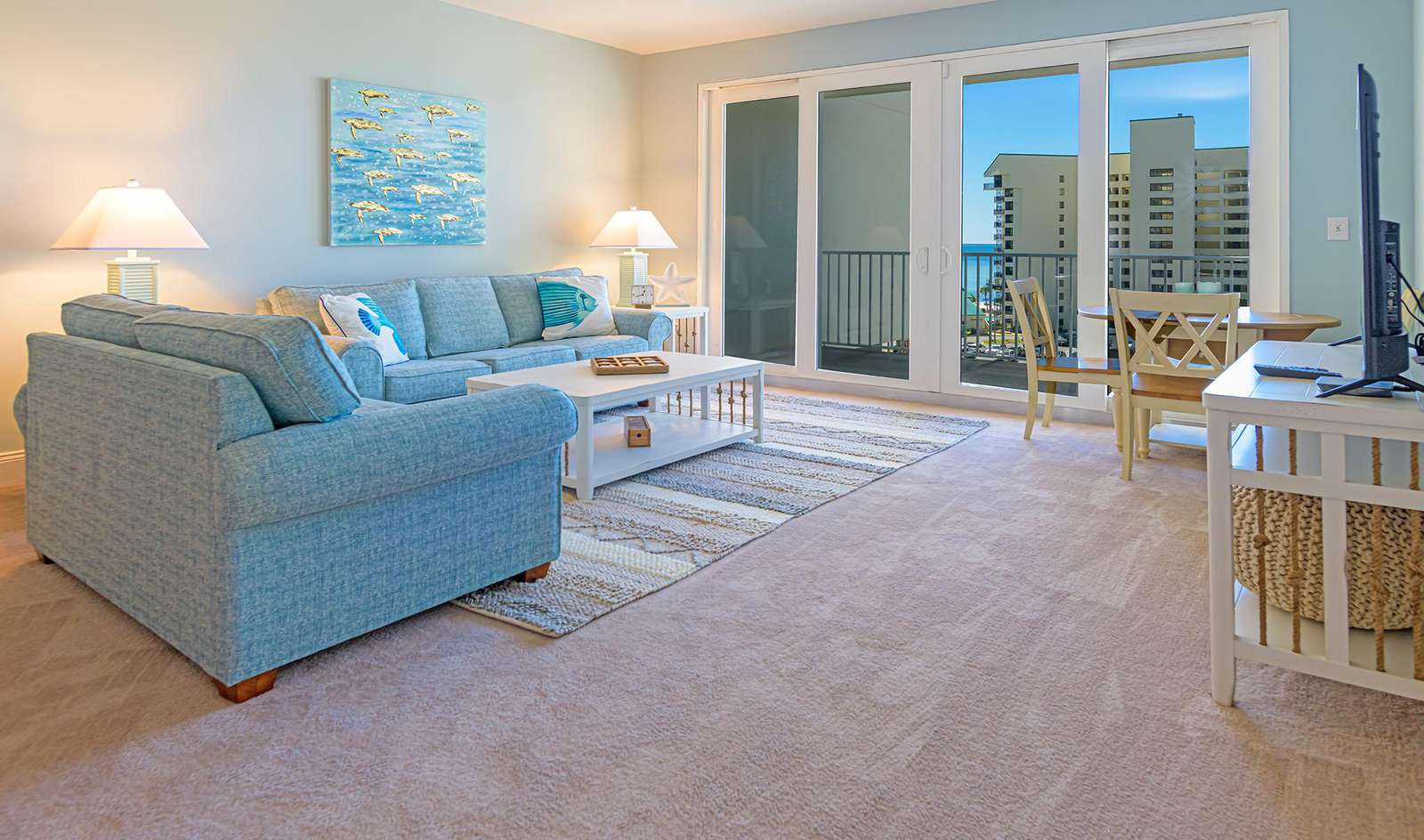 The living area also includes sleeper sofa and balcony access!