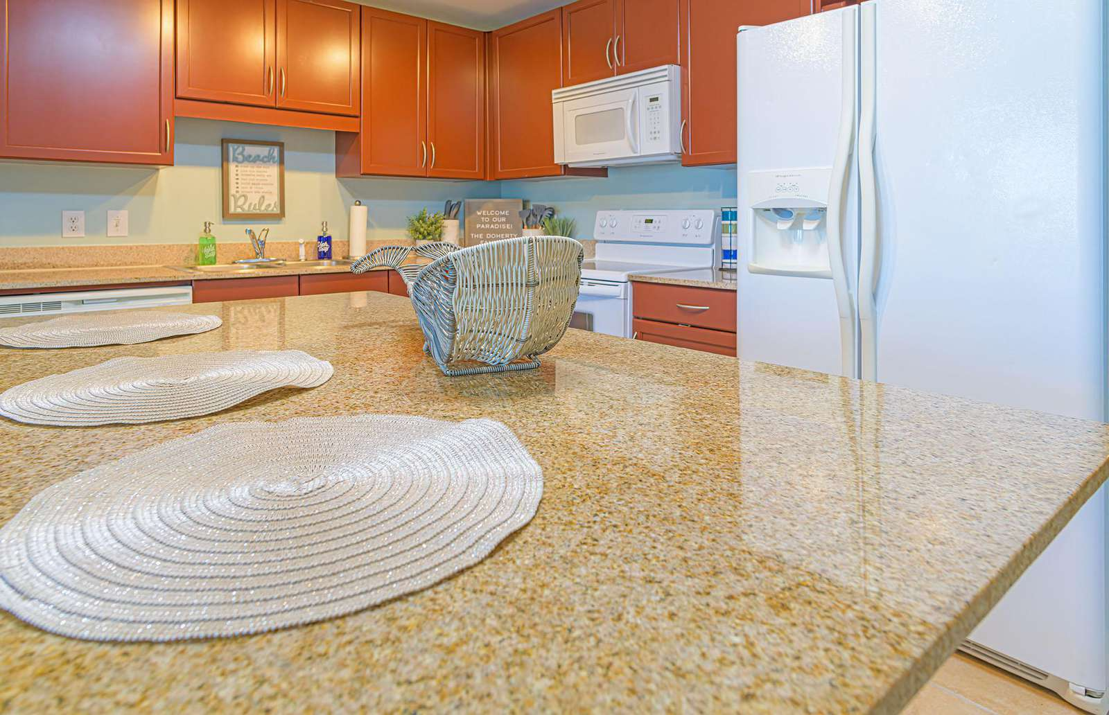 The eat-in kitchen with large island is stocked with the basics!