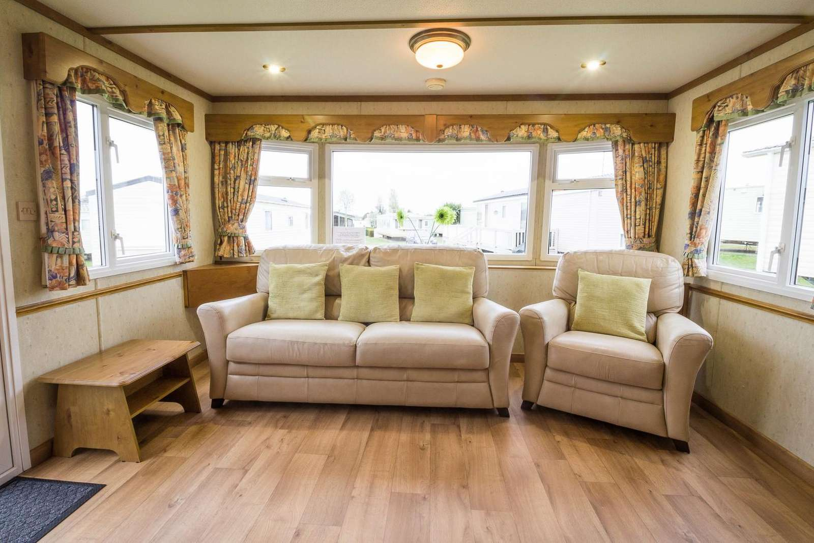 Large caravan for hire with comfortable seating.