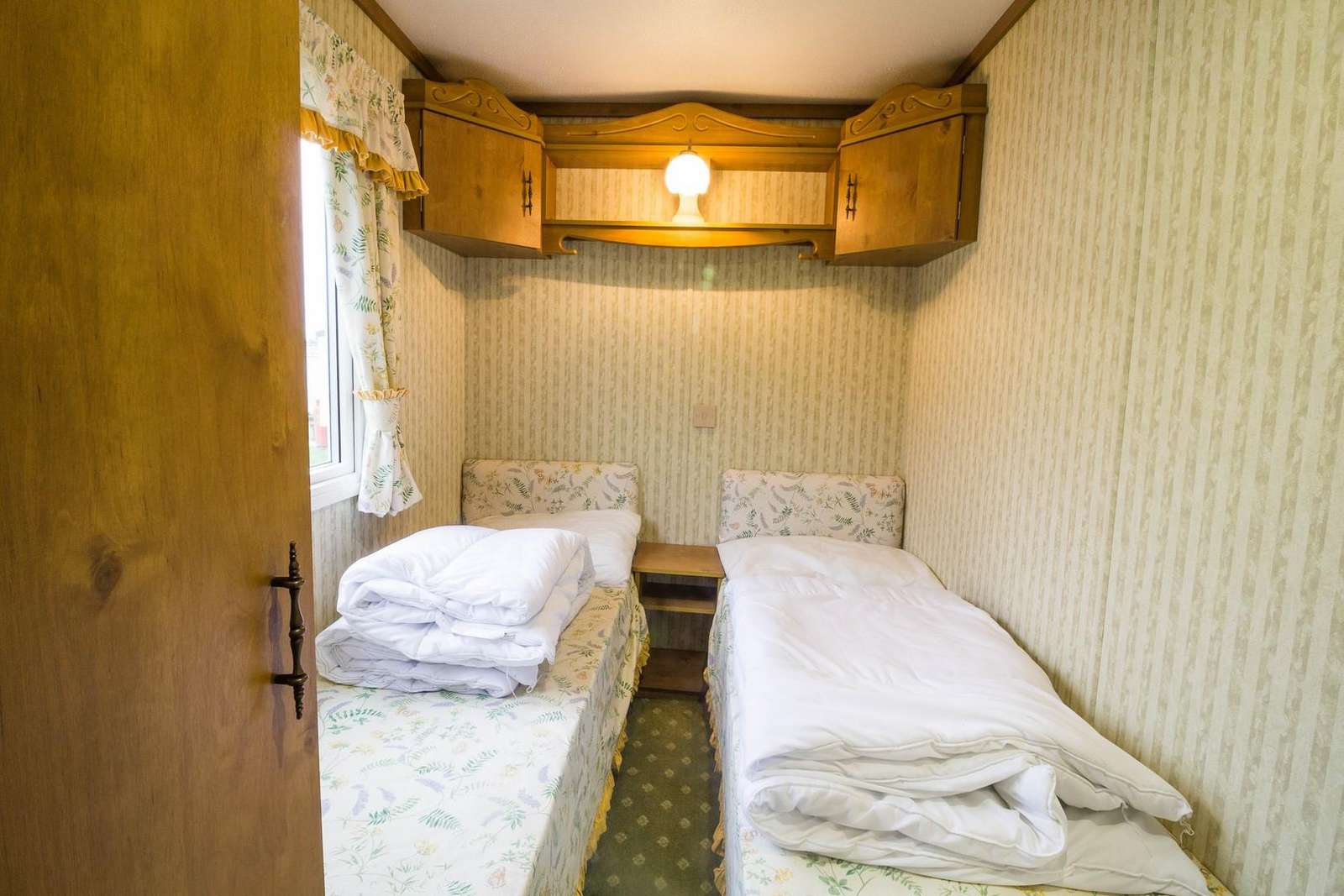 Twin room in this 3 bed roomed caravan for hire.