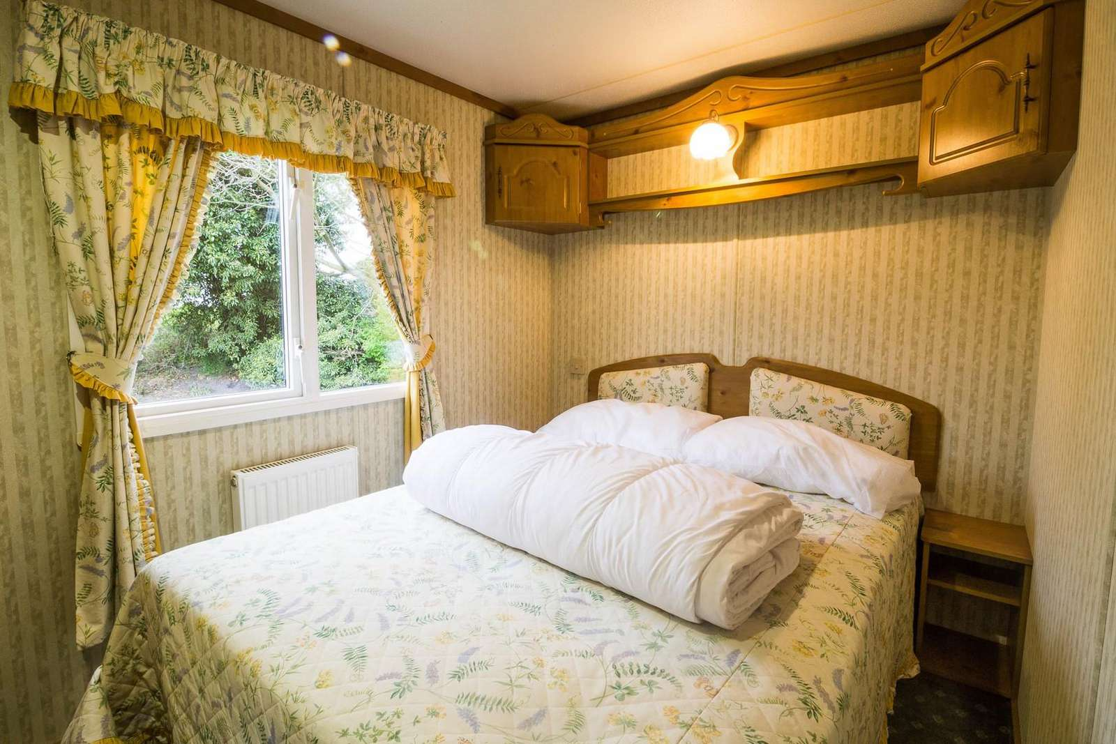 Spacious double bedroom in this 3 bed roomed caravan for hire.