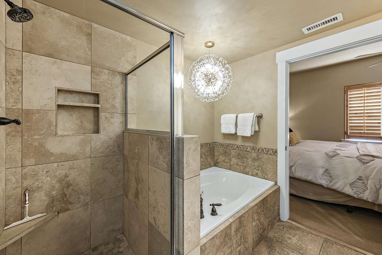 Master bathroom with large tub and shower