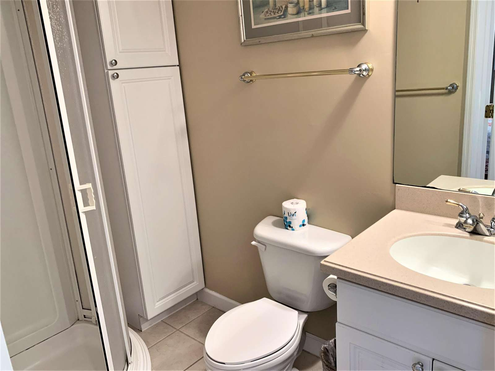Bath with shower, vanity, and storage