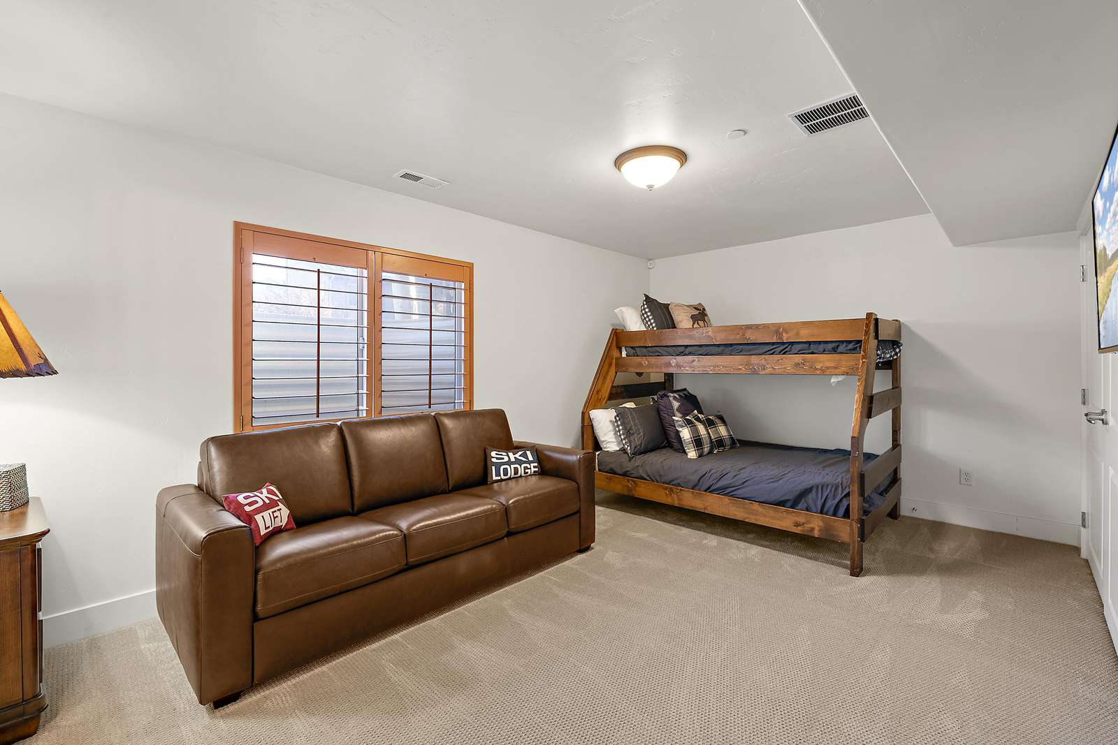 Bunk bed and sofa bed in downstairs living area