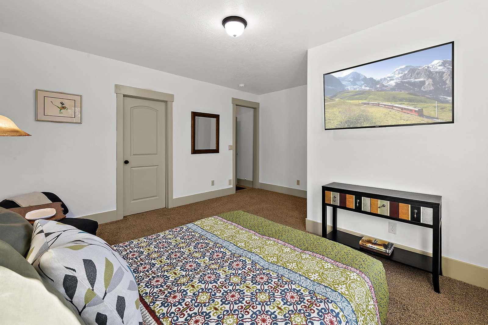 Guest bedroom features flat screen TV
