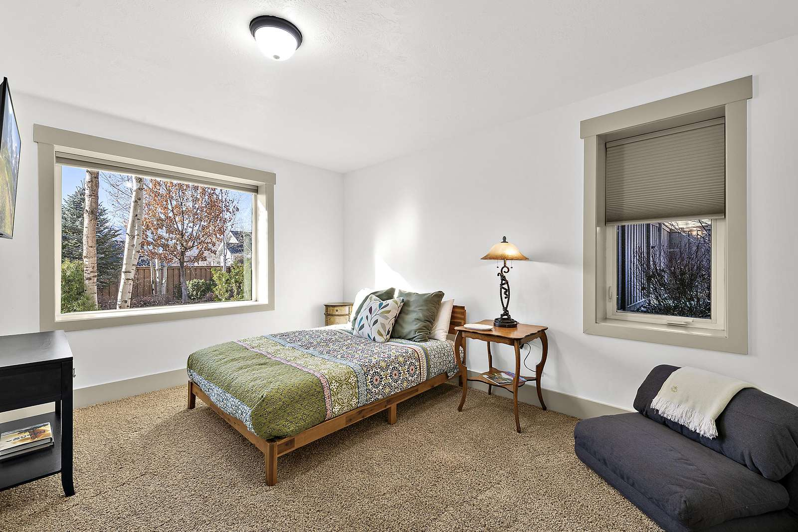 Guest bedroom with window views