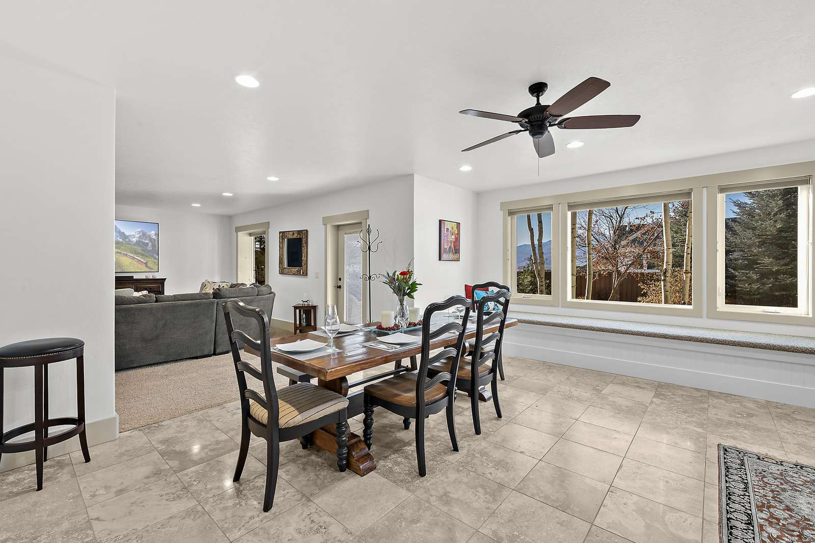 Dining area near large windows and bench seating