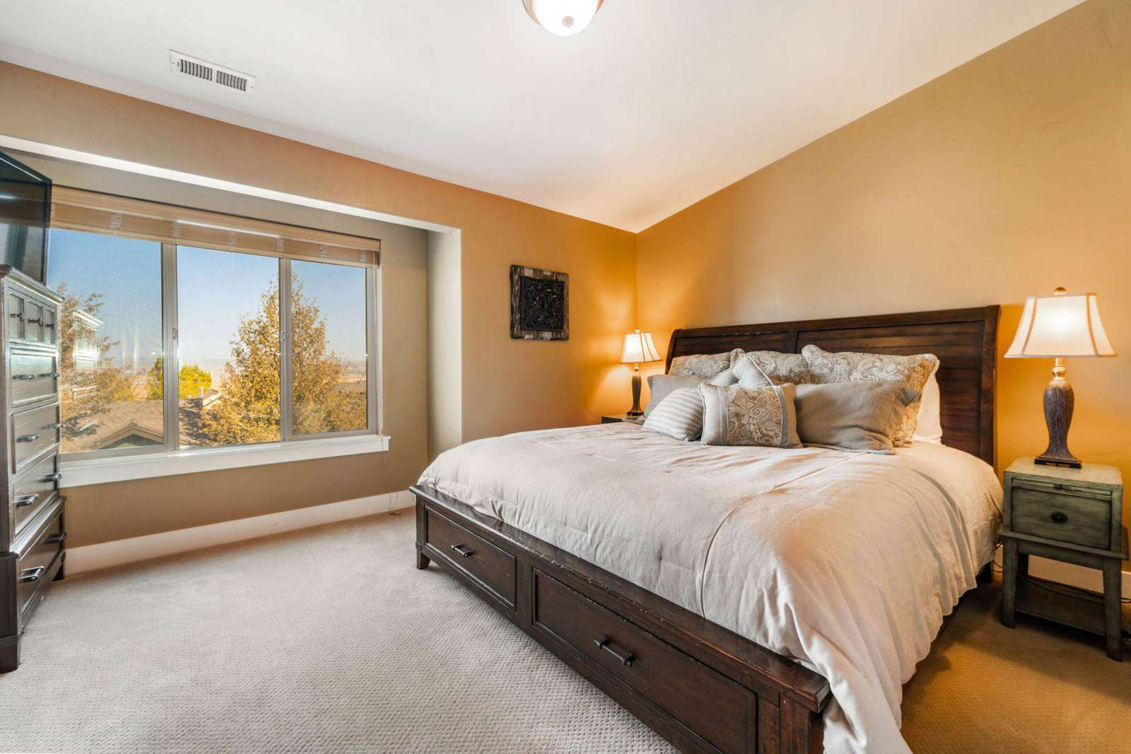 Guest bedroom with dresser and TV